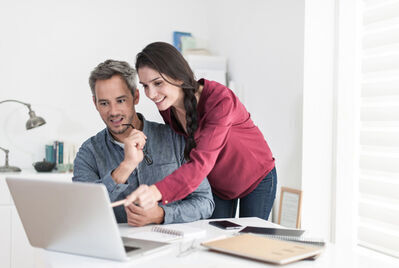 Man and woman over laptop